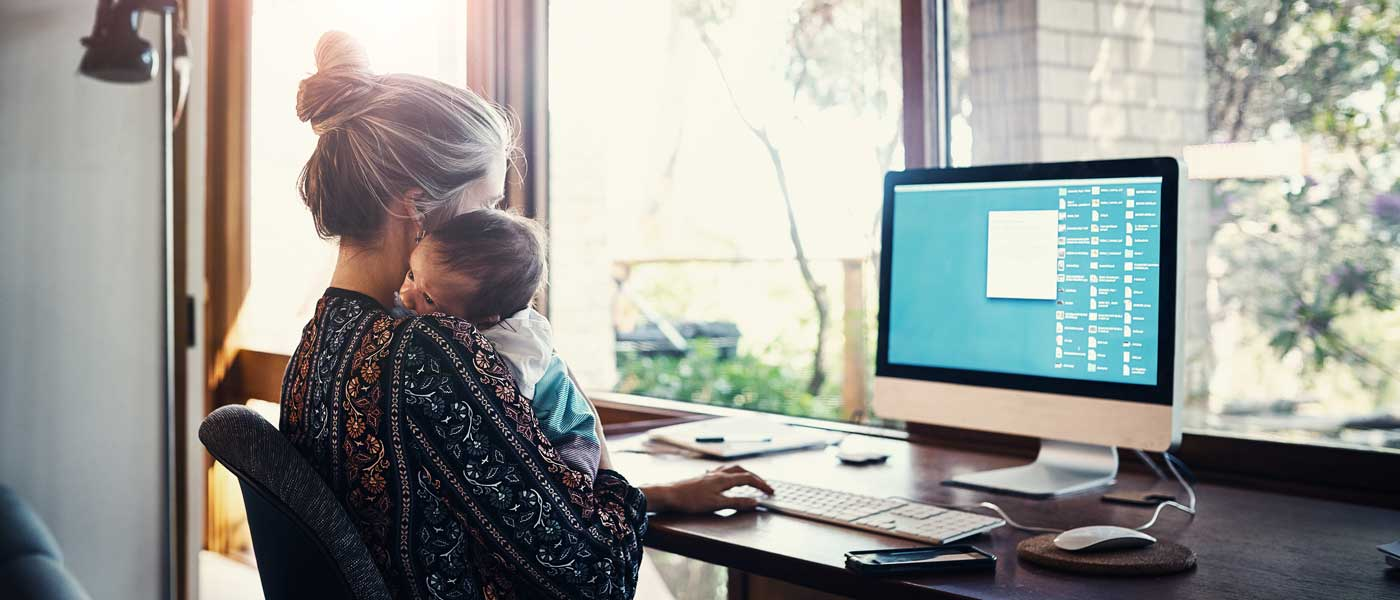 Photo of man, woman and child looking at a laptop